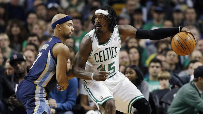 Memphis Grizzlies' Jerryd Bayless, left, defends against Boston Celtics' Gerald Wallace (45) in the third quarter of an NBA basketball game in Boston, Wednesday, Nov. 27, 2013. The Grizzlies won 100-93