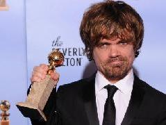 The winner for Best Performance by an Actor in a Supporting Role in a Series, Mini-Series or Motion Picture Made for Television Peter Dinklage poses with the trophy at the 69th annual Golden Globe Awards at the Beverly Hilton Hotel in Beverly Hills, January 15, 2012 -- AFP