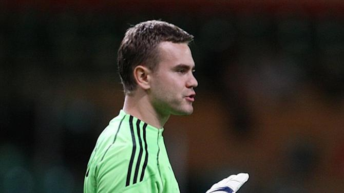 Football - Russia's Akinfeev struck by flare