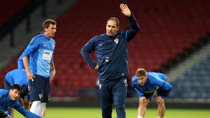 Croatia's manager Igor Stimac gestures to his squad during a team training session at Hampden Park, Glasgow, Scotland, Monday Oct. 14, 2013. Croatia face Scotland in a World Cup qualifying Group A  soccer match on Tuesday