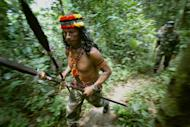 File picture shows an Huaorani tribal instructor teaching jungle survival techniques to troops, in the Amazonian province of Orellana, Ecuador. Amazon tribesmen killed at least 18 people in an apparent revenge attack against a rival group in Ecuador, an indigenous leader said Thursday