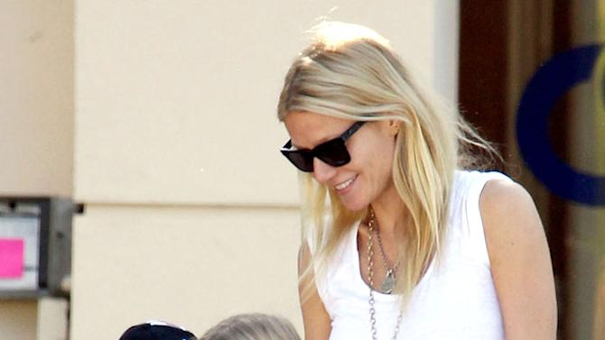 Gwyneth Paltrow looks like a very happy mom as she picks her children Moses and Apple up from school in Los Angeles