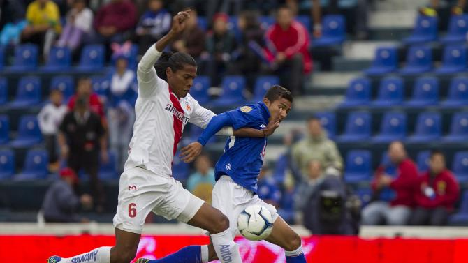 Cruz Azul's Joao Rojas, right, fights for the ball with Morelia's Joel Huiqui during a Mexican soccer league match in Mexico City, Saturday, Nov. 2, 2013
