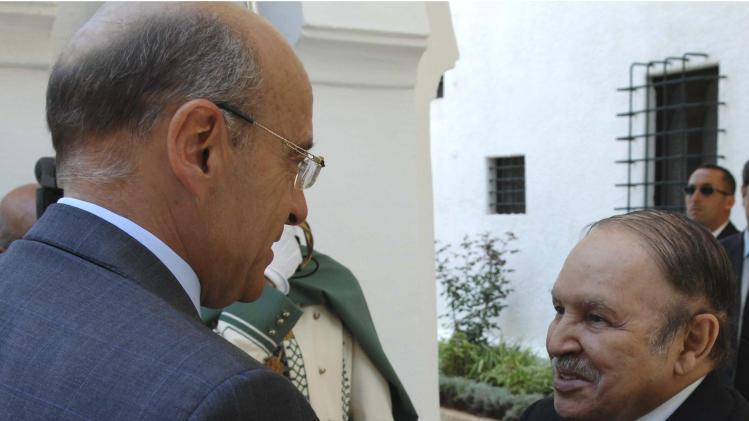 Algerian President Abdelaziz Bouteflika, right, welcomes French Foreign Minister Alain Juppe before their talks in Algiers, Thursday June, 16, 2011.Visiting French Foreign Minister Alain Juppe on Thursday defended Algeria against Libyan rebel accusations it is militarily aiding Moammar Gadhafi's regime, even as the two countries disagree over how to approach the conflict. (AP Photo/Sidali Djarboub)