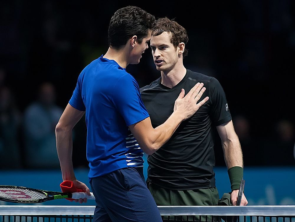 Two exhausted tennis players meet at the net after a draining semi-final at the ATP Tour Finals. (Mark Greenwood/IPS/REX/Shutterstock)