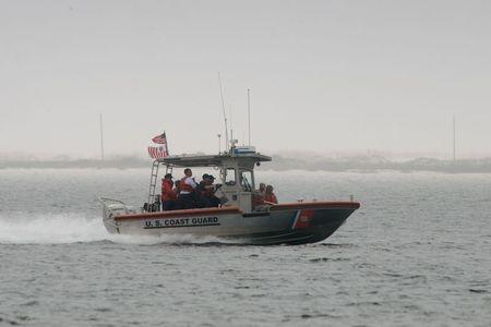 Rescue crews search waters near Navarre Bridge, east of Pensacola, Florida March 11, 2015. Seven Marines and four soldiers were unaccounted for early on Wednesday morning after their Army helicopter crashed during a night time training mission, according to military officials. REUTERS/Michael Spooneybarger