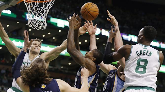 Boston Celtics' Kris Humphries, left, and Jeff Green (8) battle for a rebound with Memphis Grizzlies' Mike Miller (13), Ed Davis, center, and Kosta Koufos, second from right, in the first quarter of an NBA basketball game in Boston, Wednesday, Nov. 27, 2013