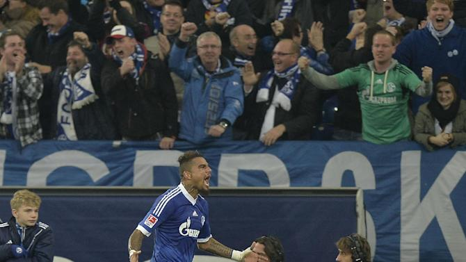 Schalke's Kevin-Prince Boateng celebrates in front of supporters after scoring his second goal during the German  Bundesliga soccer match between FC Schalke 04 and Werder Bremen in Gelsenkirchen, Germany, Saturday, Nov. 9, 2013