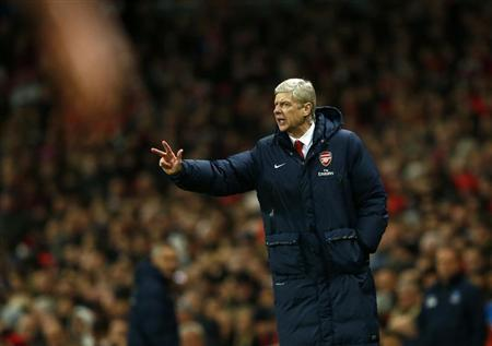Arsenal manager Wenger gestures during their English Premier League soccer match against Crystal Palace at the Emirates stadium in London
