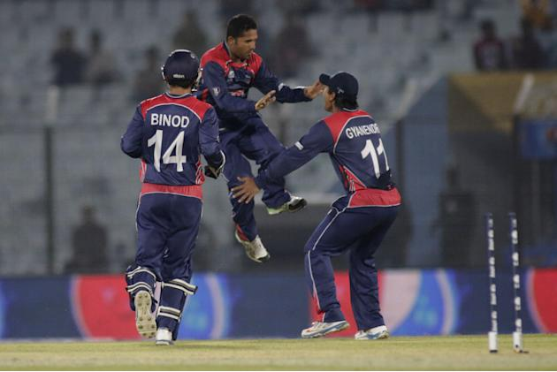 Nepalese players celebrate the dismissal of Hong Kong's Mark Chapman during their ICC Twenty20 Cricket World Cup match in Chittagong, Bangladesh, Sunday, March 16, 2014. (AP Photo/Bikas Das)