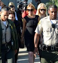Lindsey Lohan her lawyer Mark Heller and her mother Dina leave Airport Courthouse after the pre-trial hearing on January 30, 2013 in Los Angeles -- Getty Images