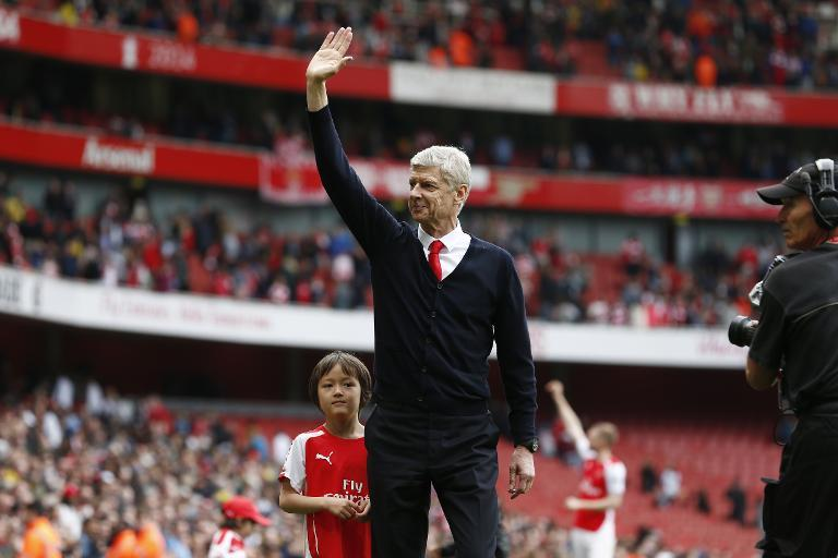 Arsenal's manager Arsene Wenger waves to supporters after their English Premier League match against West Bromwich Albion at the Emirates Stadium on May 24, 2015