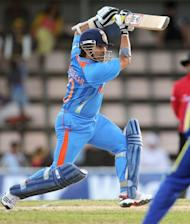 Indian batsman Sachin Tendulkar drives a ball in the ODI against Sri Lanka on Tuesday. Virat Kohli blasted an unbeaten 133 off just 86 balls as India's stunning seven-wicket bonus point victory over Sri Lanka kept them alive in the tri one-day series in Hobart on Tuesday. Openers Virender Sehwag (30 off 16 balls) and Sachin Tendulkar (39 off 30 balls) gave India a flying start