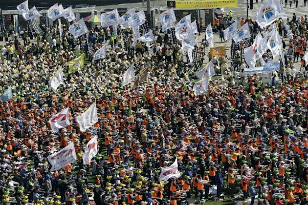 Members of Korean Confederation of Trade Unions and members of labor union of state employees perform during a rally against the government labor policy in front of the Seoul City Hall in Seoul, South
