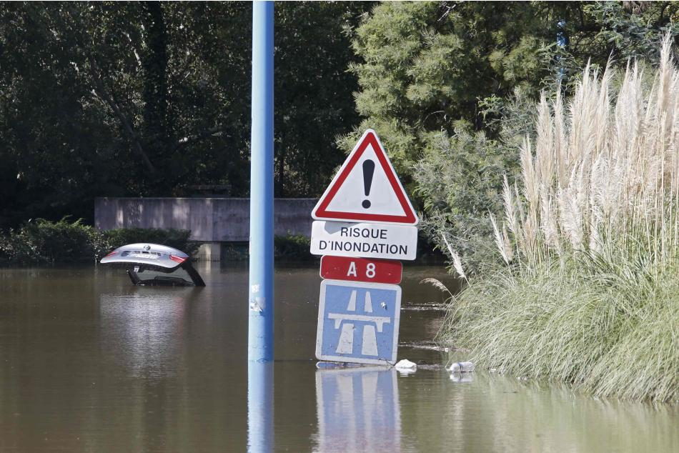 An abandoned car is submerged in deep water near an underpass by the autoroute after flooding caused by torrential rain in Mandelieu