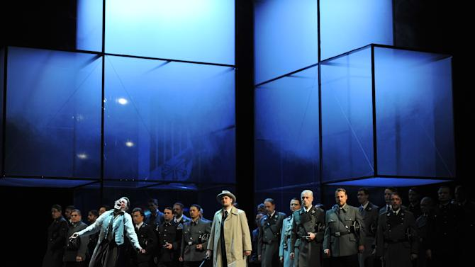 "The photo provided by Deutsche Oper am Rhein in Duesseldorf, western Germany, shows Markus Eiche, left, as Wolfram and Thorsten Gruembel as Landgraf performing in front of the choir in a scene of the the opera 'Tannhaeuser' during the dress rehearsal on April 30, 2013. The modern production of Richard Wagner's opera Tannhauser has caused a stir in Germany because of Nazi-themed scenes showing people dying in gas chambers and a family getting their heads shaved and executed. A spokeswoman for the Duesseldorf opera house said Tuesday that members of the audience ""booed and were shocked"" by Saturday's, May 3, 2013 opening performance. (AP Photo/Deutsche Oper am Rhein, Hans Joerg Michel) Mandatory Credit"