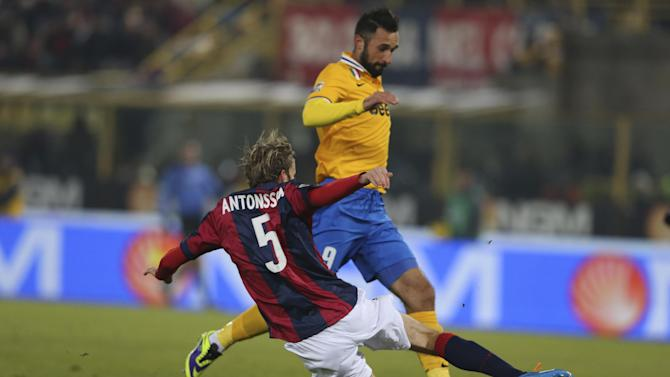 Juventus' Mirko Vucinic is tackled by Bologna defender Mikael Antonsson, of Sweden, during the Serie A soccer match between Bologna and Juventus at the Dall' Ara stadium in Bologna, Italy, Friday, Dec. 6, 2013