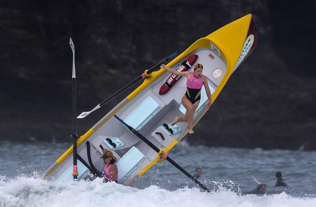 Alison Cragie, a member of a women's surf boat crew, is thrown from the boat by a breaking wave during a race in the Day of Giants Surf Boat Competition being held at Piha Beach, located west of A