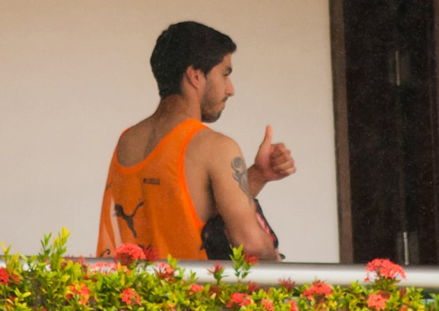 Uruguay's Luis Suarez gives a thumbs-up from a balcony of the team's hotel in Natal (Reuters)