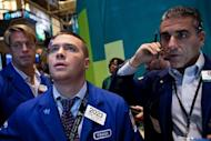 Traders work on the floor of the New York Stock Exchange. World stock markets surged Friday, the euro jumped against the dollar, and oil prices rocketed after a key EU summit delivered surprise emergency measures to fight the eurozone debt crisis