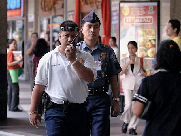 Policemen patrol in suburban Manila on February 16, 2005. An Australian resident of Hong Kong has been arrested for sexually abusing children in the Philippines, police said Tuesday