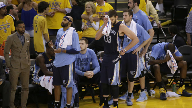 Injured Memphis Grizzlies guard Mike Conley, left,  guard Vince Carter,  second from left, center Marc Gasol (33) and forward Zach Randolph, sitting at right, react during the second half of Game 1 in a second-round NBA playoff basketball series against the Golden State Warriors in Oakland, Calif., Sunday, May 3, 2015. (AP Photo/Jeff Chiu)