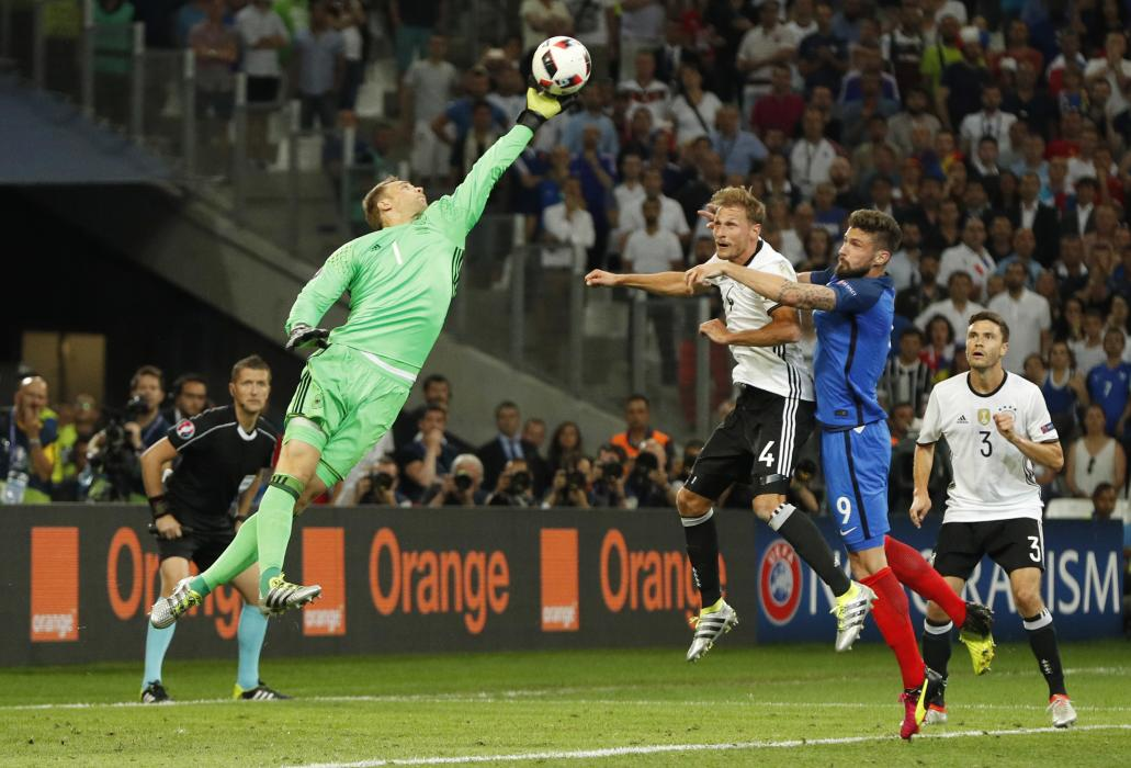 Germany's Manuel Neuer attempts to claim the ball ahead of France's Olivier Giroud