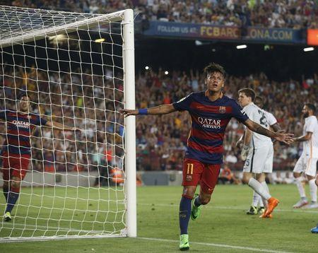 Barcelona's Neymar celebrates a goal against AS Roma during a friendly match at Camp Nou stadium in Barcelona
