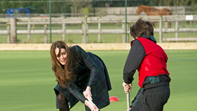 "Kate, the Duchess of Cambridge, plays hockey during her visit to St. Andrew's School, where she  attended school from 1986 till 1995, in Pangbourne, England, Friday, Nov. 30, 2012. The Duchess of Cambridge has gone back to school. The royal, formerly known as Kate Middleton, played hockey and revealed her childhood nickname — Squeak — when she returned to her elementary school for a visit Friday. Kate told teachers and students at the private St. Andrew's School in southern England that her 10 years there were ""some of my happiest years."" She said that she enjoyed it so much that she had told her mother she wanted to return as a teacher. (AP Photo/Arthur Edwards, Pool)"