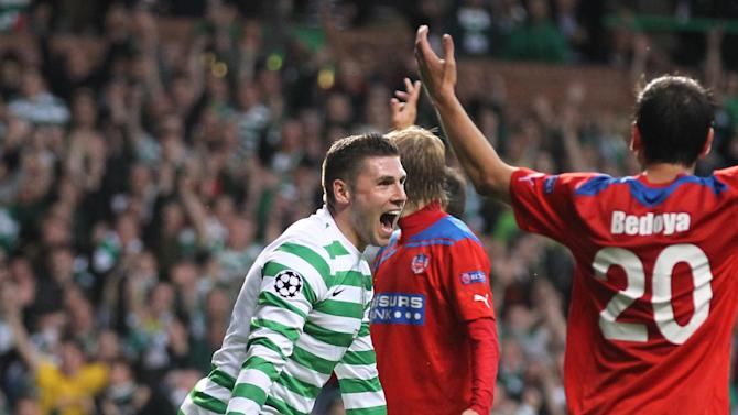 Celtic's Gary Hooper, left, celebrates scoring during the UEFA Champions League match at Celtic Park