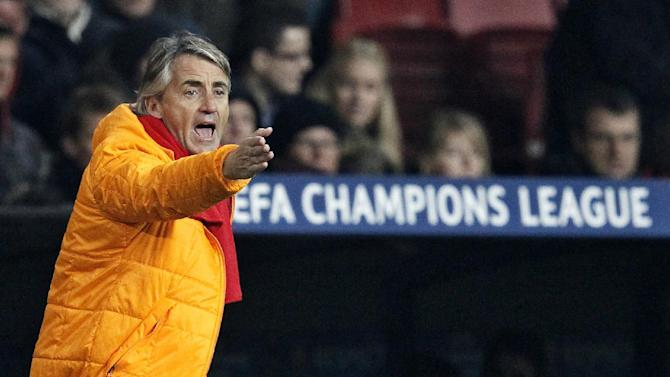 Galatasaray coach Roberto Mancini of Italy gestures to his players during their Champions League Group B soccer match against Copenhagen FC at Parken Stadium, Copenhagen, Denmark, Tuesday, Nov. 5, 2013