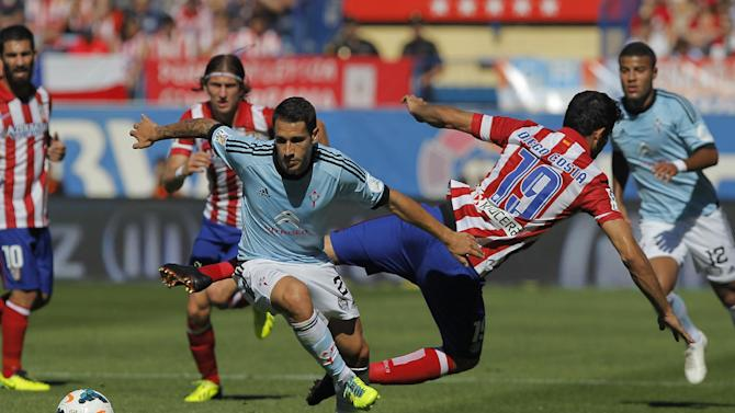 Atletico de Madrid's Diego Costa from Brazil, centre right, in action with Celta de Vigo's Hugo Mallo, centre left, during a Spanish La Liga soccer match at the Vicente Calderon stadium in Madrid, Spain, Sunday, Oct. 6, 2013