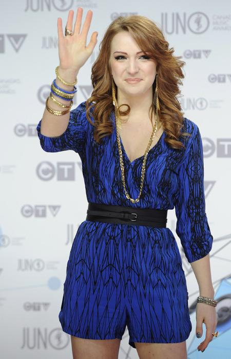 Newcomer Victoria Duffield is cute in a blue romper with a cute scribble pattern and belt. The gold and blue jewelry are a great addition to the youthful and quirky outfit. THE CANADIAN PRESS/Sean Kil