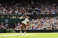 US player Serena Williams serves during her women's singles semi-final victory over Belarus's Victoria Azarenka on day 10 of the 2012 Wimbledon Championships tennis tournament at the All England Tennis Club in Wimbledon, southwest London. Serena reached a seventh Wimbledon final on Thursday, taking her aces total to 85, an intimidating statistic