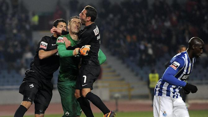 Academica's goalkeeper Ricardo Nunes, second left, celebrates with teammates after saving a penalty from FC Porto's Danilo Silva, not pictured, from Brazil in a Portuguese League soccer match at the Municipal Stadium in Coimbra, Portugal, Saturday, Nov. 30, 2013. Academica won 1-0 causing Porto's first defeat in the championship