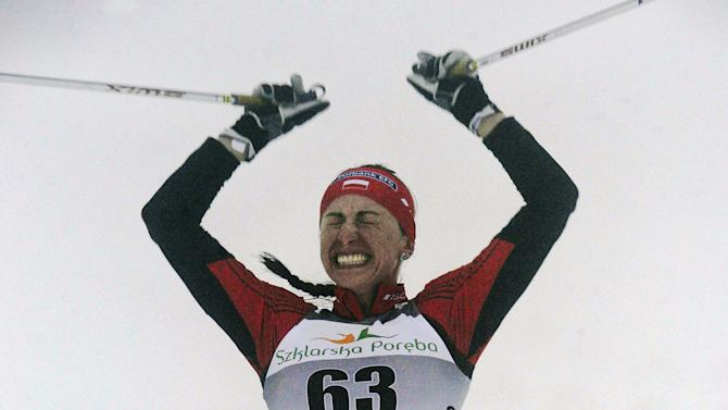 Poland's Justyna Kowalczyk reacts after crossing the finish line of the women's 10 km classic race during the 15th Cross-country Skiing World Cup in Szklarska Poreba on February 18, 2012. Kowalczyk won the event. AFP PHOTO / JANEK SKARZYNSKI (Photo credit should read JANEK SKARZYNSKI/AFP/Getty Images)