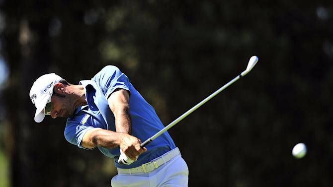 Spanish golfer Alvaro Quiros drives from