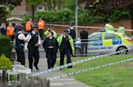 Police officers man a cordoned off area in Woolwich, east London, on May 22, 2013, following an incident in which a man was killed and two others seriously injured. British police shot and wounded two men, a senior officer said Wednesday, after reports that a soldier was killed near a London army barracks in a suspected Islamist attack.