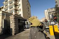 A security guard tries to stop photos being taken outside the housing compound where jailed Nobel peace laureate Liu Xiaobo and his wife live, on December 28, 2010. Two Hong Kong journalists say they were beaten up by a group of unidentified men when they were filming an activist's attempt to visit Liu Xia, the wife of Liu Xiaobo