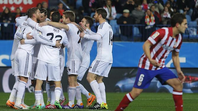 Real's Cristiano Ronaldo cerebrates his goal with teammates during a semi final, 2nd leg, Copa del Rey soccer match between Atletico de Madrid and Real Madrid at the Vicente Calderon stadium in Madrid, Spain, Tuesday, Feb. 11, 2014