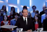 "France's Socialist Party (PS) presidential candidate Francois Hollande takes part in the TV show ""Le grand journal"" on a set of French TV Canal+"