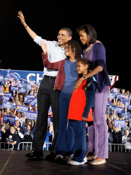 Democratic presidential nominee U.S. Sen. Barack Obama (D-IL) and his wife Michelle stand with their daughters Malia (L) and Sasha during a campaign rally at Parkview High School November 1, 2008 in S