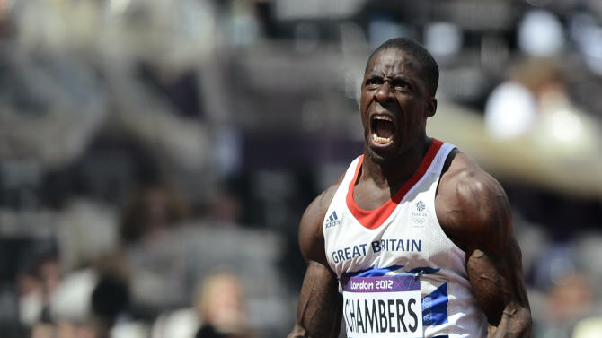 Britain's Dwain Chambers celebrates after finishing first in his men's 100m round 1 heats at the London 2012 Olympic Games at the Olympic Stadium