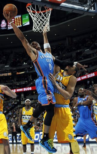 Nuggets snap Thunder's win streak with OT victory