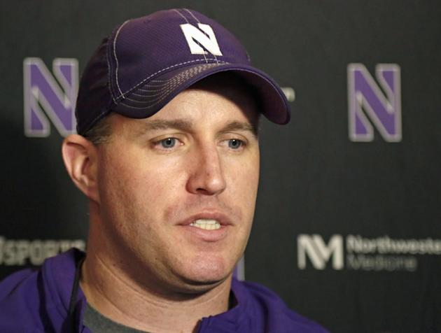 In this April 1, 2014, file photo, Northwestern football coach Pat Fitzgerald speaks at a news conference after his football team participated in an NCAA college spring practice in Evanston, Ill. Nort