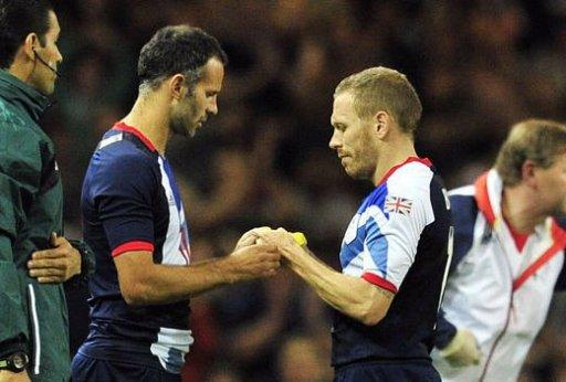 Britain's midfielder Ryan Giggs (L) comes on as a substitute for striker Craig Bellamy (R)