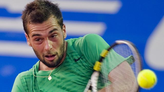 Tennis - Paire beats Simon to reach Montpellier semis