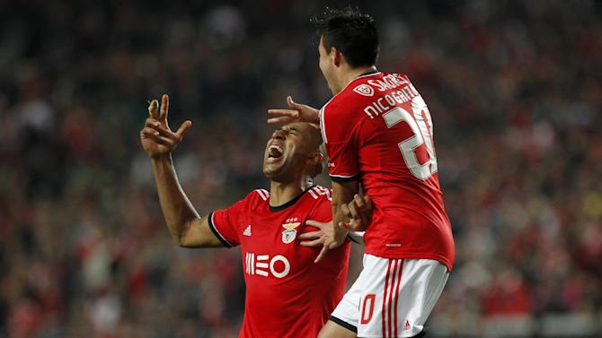 Benfica's Luisao from Brazil, left, celebrates with teammate Nico Gaitan from Argentina after scoring their team's fourth goal against Sporting during the extra time of a Portugal Cup soccer match between Benfica and Sporting at Benfica's Luz stadium in Lisbon, Saturday, Nov. 9, 2013