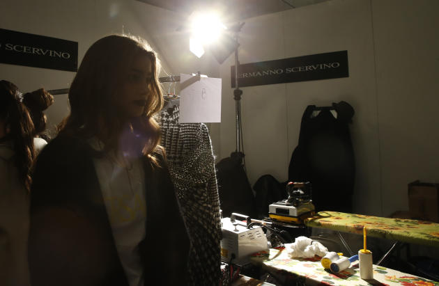 A model waits in the backstage prior to the start of the Ermanno Scervino women's Fall-Winter 2015-16 show, part of the Milan Fashion Week, unveiled in Milan, Italy, Saturday, Feb. 28, 2015. (AP P