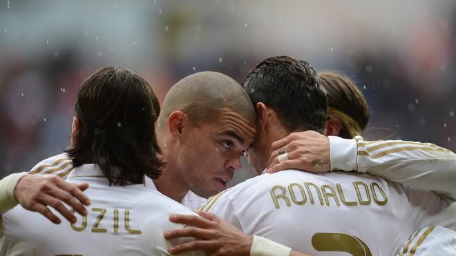 Real Madrid's Portuguese Forward Cristiano Ronaldo (R) Celebrates AFP/Getty Images